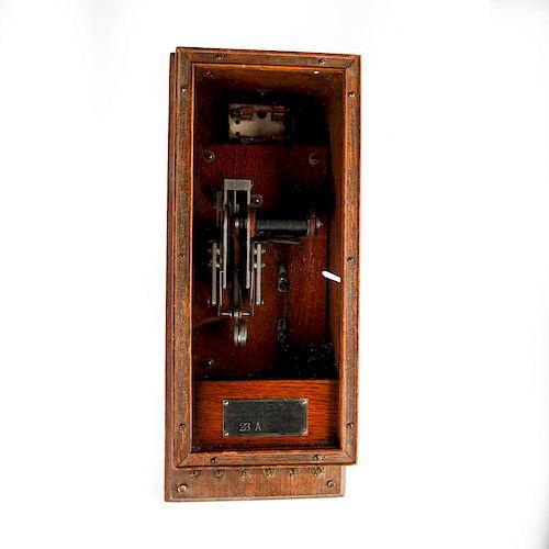 19TH CENTURY KELLOGG TELEPHONE SWITCHER, WOODEN CABINET