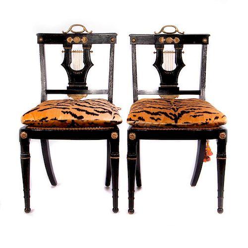 Four Ebonized side chairs.