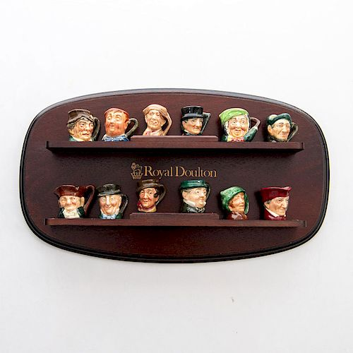 12 TINY ROYAL DOULTON CHARACTER JUGS WITH WALL STAND
