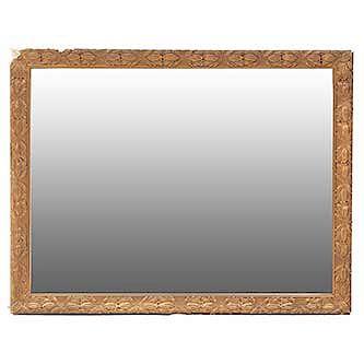 Espejo. SXX. En talla de madera dorada y yesería. Con espejo de luna rectangular. 89 x 114 x 4 cm.