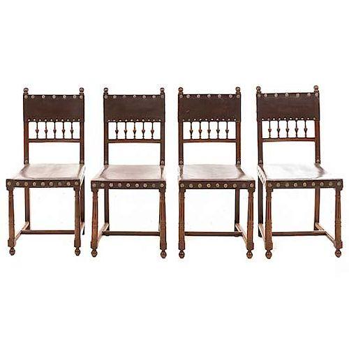 Lote de 4 sillas. Francia. Siglo XX. Estilo Enrique II. En talla de madera de nogal. Con respaldos semiabiertos y asientos tipo piel.