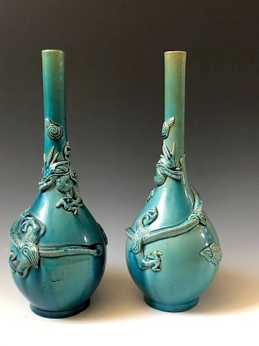 A PAIR OF CHINESE ANTIQUE BLUE GLAZED DRAGON VASES. 19 CENTURY