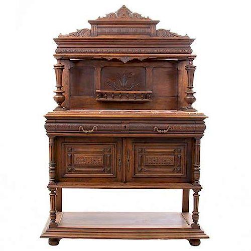 Aparador. Francia. SXX. Estilo Enrique II. En talla de madera de nogal. Con cubierta de mármol, 2 cajones y 2 puertas. 190 x 127 x 48cm