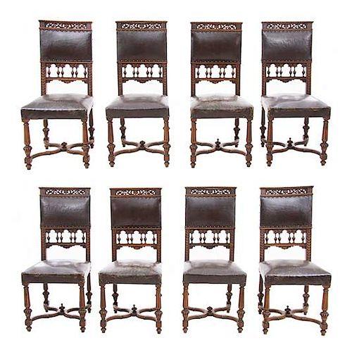 Lote de 8 sillas. Francia. Siglo XX. Estilo Enrique II. En madera de nogal. Con respaldos semiabiertos y asientos de tipo piel.