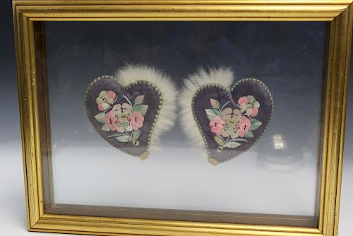 A pair of Chinese embroidery ear muffs. framed.