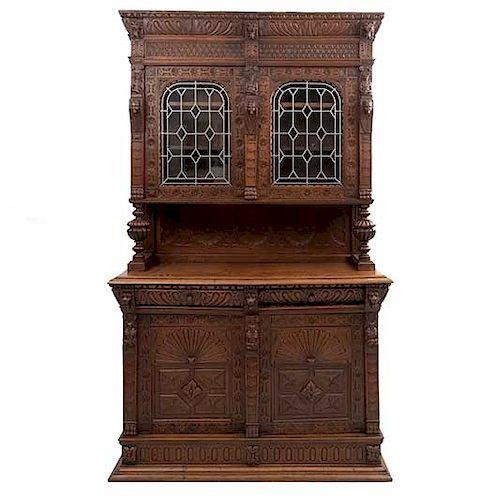 Buffet. Francia. Siglo XX. Estilo Enrique II. En talla de madera de roble. A 2 cuerpos. Con 2 cajones y 4 puertas. 230 x 135 x 49 cm.