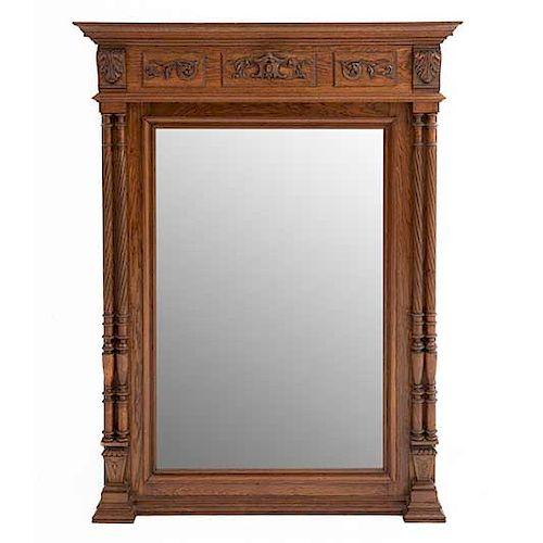 Espejo. Francia. Siglo XX. Estilo Enrique II. En talla de madera de roble. Con luna rectangular biselada. 128 x 96 x 12 cm.