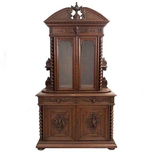 Buffet. Francia. Siglo XX. Estilo Enrique II. En talla de madera de roble. A 2 cuerpos. Con 2 cajones y 4 puertas. 255 x 138 x 60 cm.