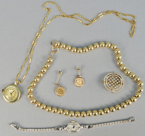 Gold lot, to include gold beads, two watches, one pin, one chain, pair of two Peso Mexican gold earrings. gross weight with watches 76.9 total grams.