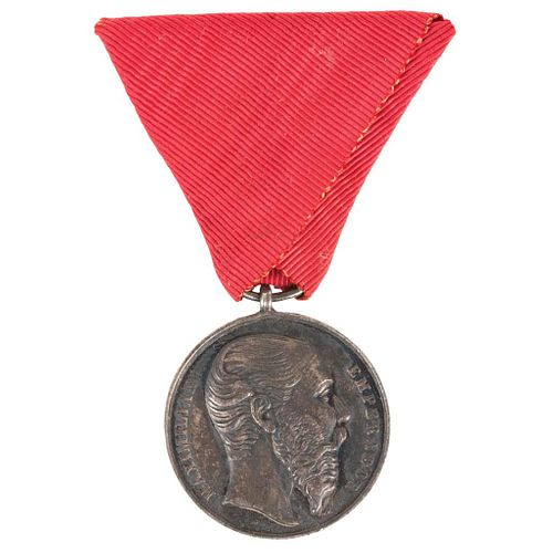 """Navalón, G. Medal of Military Merit. Silver, 0.01"""" (32 mm). Given by the Emperor Maximilian. Ribbon in red silk."""