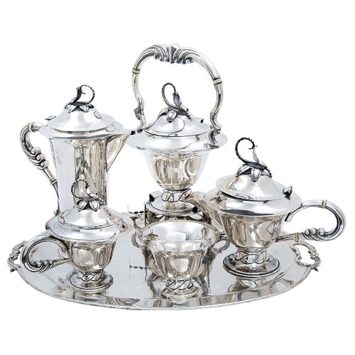 Tea and Coffee Set. Mexico. 20th Century. VILLA Sterling Silver 0.925. Design with chiseled handles and vegetable motif.