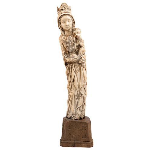 Virgin with Child. Europe. 19th Century. Carved ivory on wooden base.