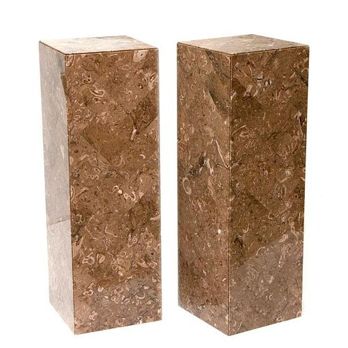 Pair of marble stands.