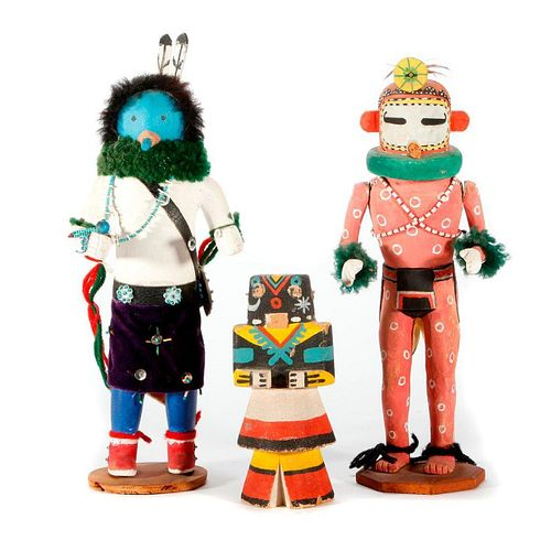 Three Kachina dolls.