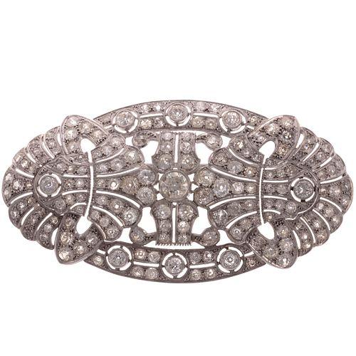 A Large Filigree Diamond Pin/Pendant in Platinum