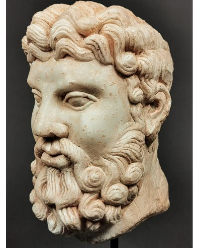 A ROMAN MARBLE HEAD OF HERCULES