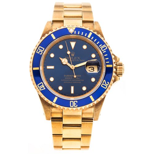 ROLEX OYSTER PERPETUAL DATE SUBMARINER. 18K YELLOW GOLD. REF. 16618, CA. 1990
