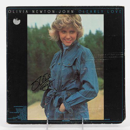 "OLIVIA NEWTON JOHN, ""CLEARLY LOVE"" SIGNED ALBUM"