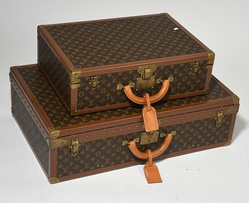 Two Louis Vuitton hard sided suitcases