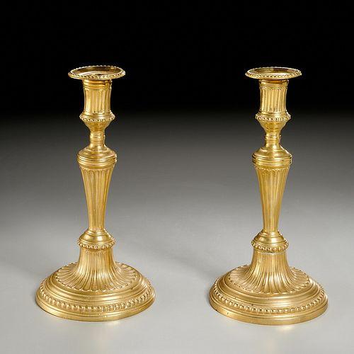 Pair signed Louis XVI gilt bronze candlesticks
