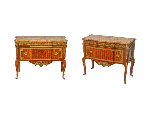 A Pair of Transitional Style Gilt Bronze Mounted Parquetry Commodes Height 34 1/2 x width 43 3/4 x depth 18 1/2 inches.