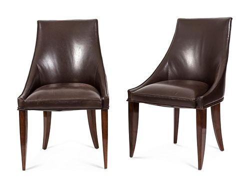 A Set of Ten French Art Deco Leather-Upholstered Rosewood Dining Chairs Height of seat 17 x width of seat 20 inches; height overall 34 inches.