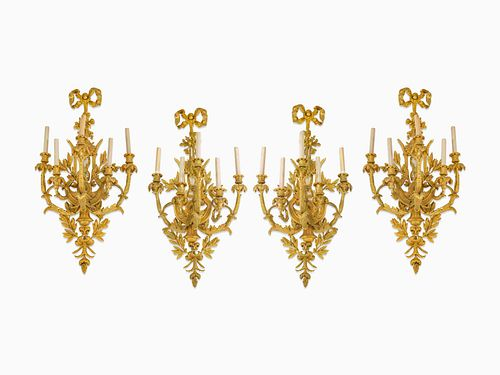 A Set of Four Louis XV Style Gilt-Bronze Five-Light Sconces Height 37 x width 19 x depth 13 1/2 inches.