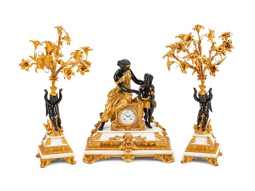 A Napoleon III Parcel-Gilt, Patinated Bronze and Marble Three-Piece Clock Garniture Height of clock 25 x width 22 x depth 10 1/2 inches; height of can