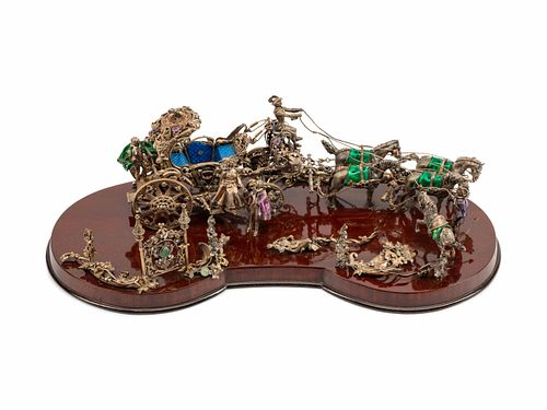 A Continental Jeweled Silver and Enamel Model of a Horse-Drawn Coach Height 8 x length 25 1/2 x depth 13 inches.