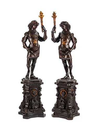 A Large Pair of English Parcel-Gilt and Stained Wood Figural Torcheres on Stands Height 78 x width 17 x depth 16 inches.