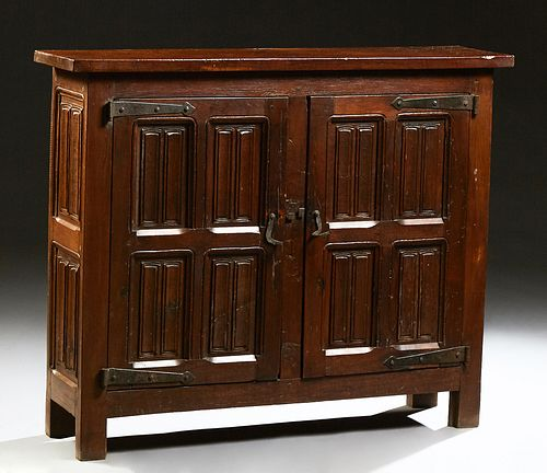 French Provincial Louis XIII Style Carved Oak Sideboard, 19th c., the rectangular top over double linenfold paneled doors with iron...