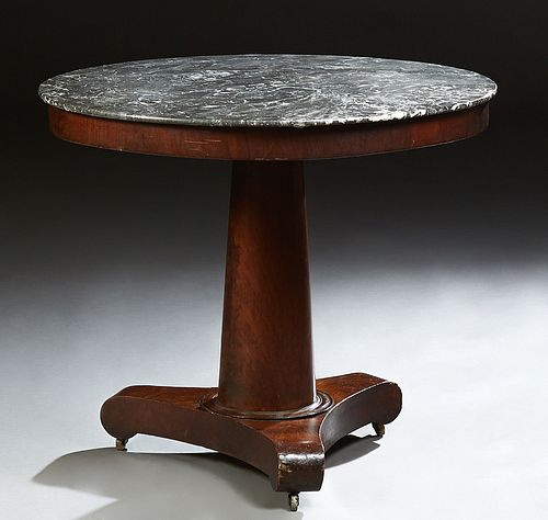 French Empire Style Carved Mahogany Marble Top Pedestal Center Table, c. 1840, the highly figured grey marble over a wide skirt, on...