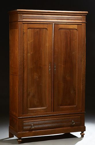 French Provincial Louis Philippe Carved Walnut and Beech Armoire, 19th c., the stepped crown over double paneled doors over a reeded...