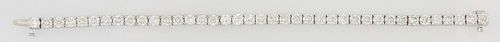 18K White Gold Diamond Tennis Bracelet, each of the 39 links with a graduated round diamond, total diamond weight- 11