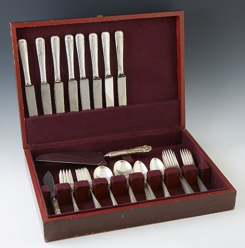 "Forty-Four Pieces of Sterling Flatware, by International, in the ""Courtship"" pattern, consisting of 10 teaspoons, 8 salad forks, 8 c..."