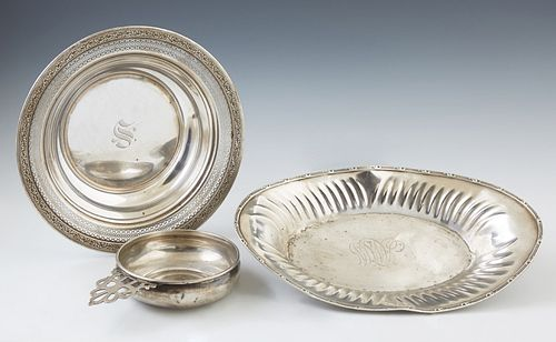 Three Pieces of Sterling, consisting of a porringer, by Gorham, #700; an oval bread bowl by Unger Brothers; and a reticulated circul...