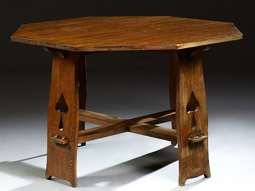 Limbert Style Caved Oak Octagonal Dining Table, late 20th c., on four wide flat legs with spade cutouts, joined by a flat X-form str...
