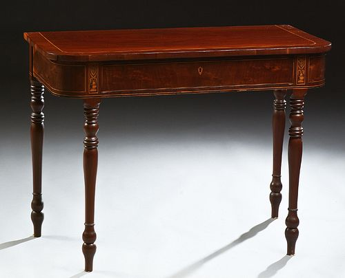 English Inlaid Mahogany Console Table, 20th c., the rounded corner top over a frieze drawer, on turned tapered legs, H.- 29 in., W.-...