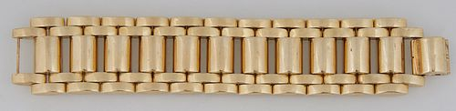 14K Yellow Gold Wide Link Bracelet, 20th c., H.- 1 3/16 in., W.- 7 1/2 in., D.- 3/16 in., Wt.- 2.47 Troy Oz. Provenance: from the co...