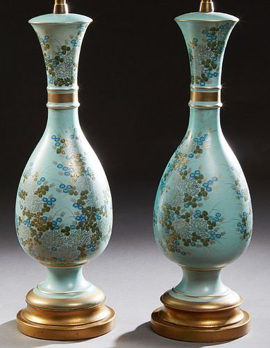 Pair of Oriental Porcelain Baluster Lamps, 20th c., with gilt, silver, and polychromed floral decoration on a pale blue ground, on s...