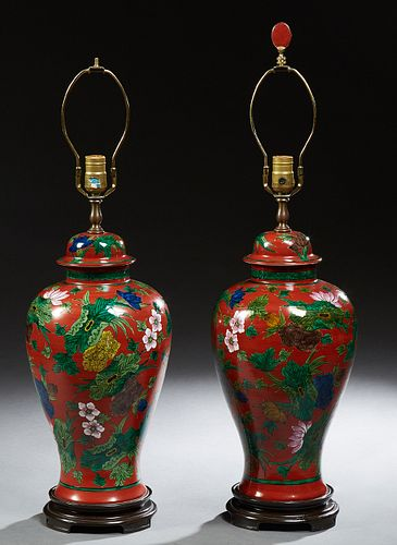 Large Pair of Oriental Porcelain Cover Baluster Ginger Jar, 20th c., with floral and leaf decoration on a read ground, now on steppe...