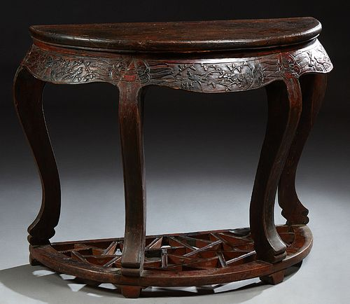 Chinese Carved Elm Demilune Console Table, 19th c., the bombe skirt with relief carving of birds and flowers, on large cabriole legs...
