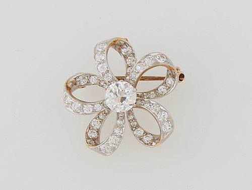 18K Yellow Gold Brooch/Pendant, early 20th c., with a central 1.25 ct. round diamond, atop five in-and-out graduated diamond mounted...
