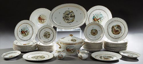 Fifty-Seven Piece Set of French Porcelain Dinnerware, 20th c., with gilt scrolled rims and hunting decoration, consisting of 23 dinn...