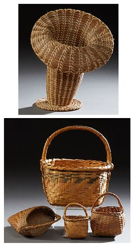 Group of Native American Baskets, 20th c., consisting of three Cherokee market baskets; a Cherokee heart-shaped flower basket; and a...