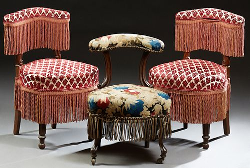 Three French Napoleon III Style Carved Mahogany Upholstered Chairs, c. 1870, each with a curved upholstered crest rail above an upho...