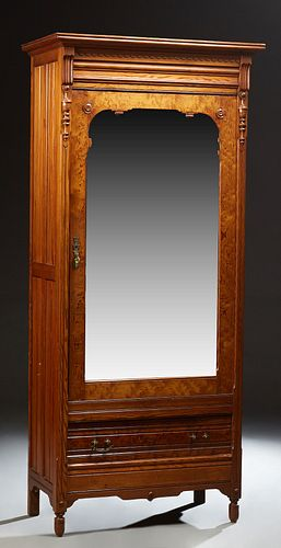 French Carved Pitch Pine Armoire, c. 1880, the stepped ogee crown over a single mirror door above a deep drawer, flanked by reeded p...