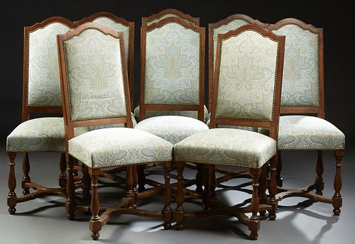 Set of Eight French Louis XVI Style Carved Walnut Upholstered Dining Chairs, early 20th c., the arched rectangular back over a trape...