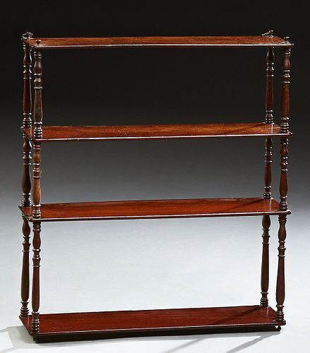 Empire Style Carved Mahogany Three Tier Wall Shelf, early 20th c., the rectangular top above three tiers joined by turned and tapere...