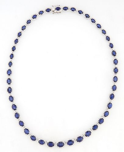 14K White Gold Link Necklace, each of the 45 oval links with a graduated oval blue sapphire, atop a border of round diamonds, total...